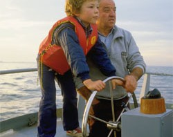 Man with Grandson on a Boat