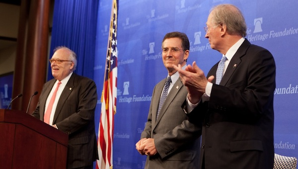 Heritage President Ed Feulner, left, announces that Sen. Jim DeMint (R-SC), center, will replace him as president in April as Chairman Tom Saunders looks on. Photo: Shealah Craighead