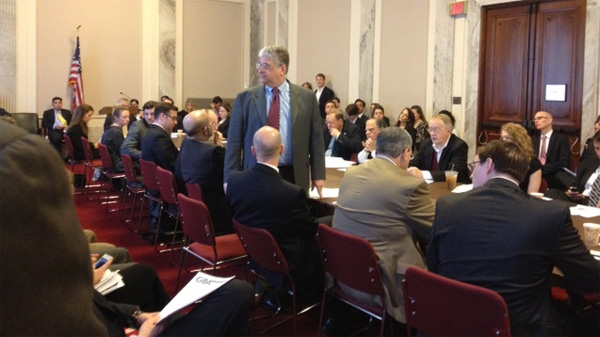 Heritage Foundation expert Robert Rector, standing, takes questions at a meeting of Capitol Hill staff today.
